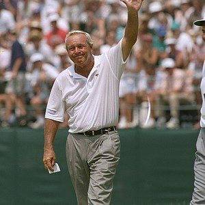Arnold Palmer acknowledges the crowd as he leaves the 18th green at the U.S. Open at Oakmont, Pa., June 17, 1994. Palmer did not make the cut, finishing at 16 over par. He called this his last U.S. Open.
