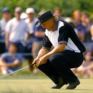 Greg Norman drops to his knees after missing a birdie putt on the sixth hole during the final round of the 95th U.S. Open at the Shinnecock Hills Golf Club in Southampton, N.Y., Sunday, June 18, 1995.