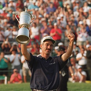 Corey Pavin holds the trophy on the 18th green after winning the 95th U.S. Open at the Shinnecock Hills Golf Club in Southampton, N.Y., Sunday, June 18, 1995.