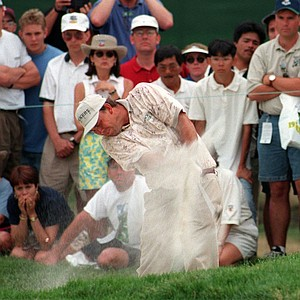 Tom Lehman hits out of a fairway bunker on the 18th hole Sunday, June 16, 1996, during the final round of the U.S. Open at Oakland Hills Country Club in Bloomfield, Mich. Lehman bogeyed the hole, missing the chance for a playoff with Steve Jones.