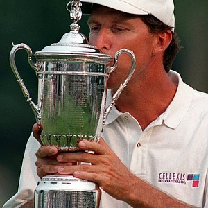 1996 U.S. Open champion Steve Jones kisses the trophy on the 18th green Sunday, June 16, 1996, at Oakland Hills Country Club in Bloomfield, Mich.