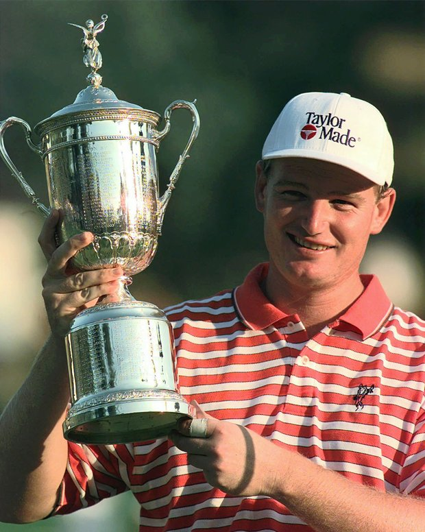 Ernie Els, of South Africa, holds up the trophy after winning the U.S. Open Sunday, June 15, 1997, at the Congressional Country Club in Bethesda, Md.
