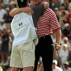 Ernie Els, of South Africa, hugs his caddie Ricci Roberts after finishing the U.S. Open Sunday, June 15, 1997, at Congressional Country Club in Bethesda, Md. Els won the 1997 U.S. Open Championship.