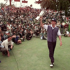 1998 U.S. Open Champion Lee Janzen shows his trophy to the gallery and photographers during the final round of the 1998 U.S. Open Championship at the Lake Course of the Olympic Club in San Francisco, Calif., Sunday, June 21, 1998.