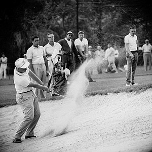 Jack Nicklaus hits from a sandtrap on the 18th green during a practice round for the U.S. Open at the Cherry Hills Country Club in Denver, Colorado on June 15, 1960.