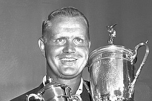 Jack Nicklaus holds his trophies after winning the U.S. Open golf Championship at the Oakmont, Pa. country club, in this June 17, 1962 photo.