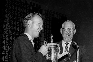 President of the USGA John Clock presents the U.S. Open trophy to Arnold Palmer, left, at the Cherry Hills Country Club in Denver, Colorado on June 18, 1960.