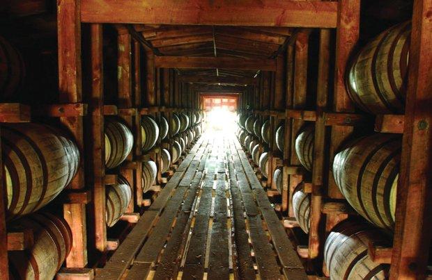 Barrels of aging bourbon line a Maker's Mark warehouse.