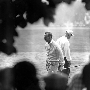 Arnold Palmer, left, and Jack Nicklaus are shown walking in opposite directions as they look over the first tee at the start of second round in the U.S. Open Golf Championship at Oakmont Country Club in Oakmont, Pa., June 15, 1962. Nicklaus, who wound up with a 71 and a 72 for first round play, won the tourney with a score of 283.