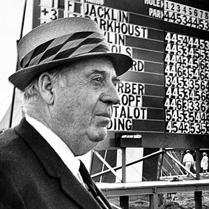 """Robert Trent Jones, designer of Hazeltine National Golf Club, surveys the layout as he stands in front of the scoreboard showing first round scores at the U.S. Open Championship in Chaska, Minn., June 19, 1970. The golf course has come under criticism from golfers participating in the tourney. Jones said, """"If you want flat greens and flat fairways, you can order it out of a Sears Robuck catalogue."""""""