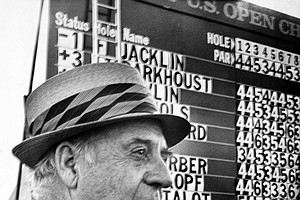"Robert Trent Jones, designer of Hazeltine National Golf Club, surveys the layout as he stands in front of the scoreboard showing first round scores at the U.S. Open Championship in Chaska, Minn., June 19, 1970. The golf course has come under criticism from golfers participating in the tourney. Jones said, ""If you want flat greens and flat fairways, you can order it out of a Sears Robuck catalogue."""