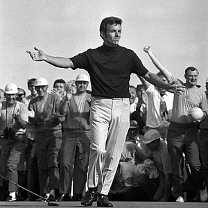 Tony Jacklin drops his putter to the ground and waves his arms after sinking his birdie putt on the eighteenth green to win the U.S. Open Championship, Chaska, Minn., June 21, 1970, in a seven-under-par 281 for 72 holes. Jacklin becomes the first Englishman in fifty years to win the U.S. Open.
