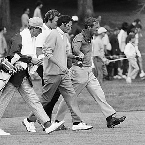 Arnold Palmer, right, Dave Hill, Center, and Ray Floyd move down fairway on third hole as they make effort to improve on their first day's scores in U.S. Open tournament . They are playing in second round in Chaska, Minnesota on June 19, 1970. Hill had moved to within two strokes of leader Tony Jacklin after five holes on Friday. Caddy at left unidentified.