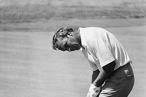 Arnold Palmer rims the cup of the 10th hole in a practice session at the Hazeltine National Golf Club prior to the start of the 70th U.S. Open Championship of Golf, June 16, 1970, Chaska, Minn. Palmer is a former winner of the U.S. Open.