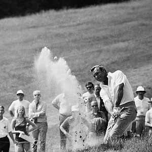 Arnold Palmer, right, blasts ball from trap onto fourth green in first round play of the 72-hole four day U.S. Open Golf Championship on Merion Golf Club Course, Thursday June 17, 1971, Ardmore, Pa. (