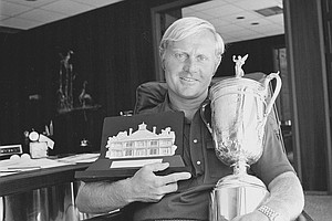Jack Nicklaus holds two trophies representing his victories this year in the U.S. Masters, left, and U.S. Open, right, at his North Palm Beach office, Fla., on June 20, 1972.
