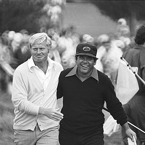 Jack Nicklaus, left, walks off the 18th green at Pebble Beach with Lee Trevino, the man he defeated as U.S. Open champion, moments after the final putt on June 18, 1972.