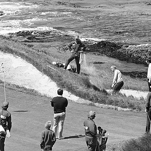 Jack Nicklaus blasts out of one trap, over another, and onto the seventh green as the roar of the surf pounds his ears during a practice round June 14, 1972 at Pebble Beach, California, where the U.S. Open begins Thursday June 17, 1972. The ball stopped six feet from the pin and Nicklaus knocked in the putt for a par 3.