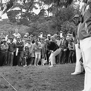 Jack Nicklaus and his gallery intently watch the flight of the ball after he hit it from the rough toward the first green, June, 15, 1972 at Pebble Beach in opening round of the U.S. Open. The ball went over the green but Nicklaus chipped it stiff to the cup to make par 4.