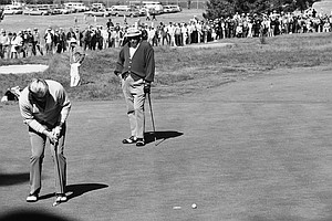 Jack Nicklaus watches a four-foot putt slip past the cup on the second green at Pebble Beach, June, 16, 1972 during the second round of the U.S. Open. He was on the green in two and was putting for an eagle from 30 feet, but came up short and then missed, settling for par 5. Watching the action is Julius Boros.