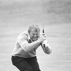 Arnold Palmer grimaces in reaction to a missed putt for a par on the eighth green during the third round of the U.S. Open at Pebble Beach, Ca. on June 17, 1972.