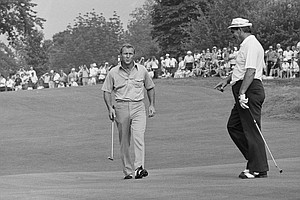 Arnold Palmer, left, swings his club as he and Julius Boros walk on to green at Oakmont Country Club where they were in a four-way tie for the lead in the end of third round of the U. S. Open Golf Championship, June 16, 1973, Oakmont, Pa. Palmer, Julius Boros, Jerry Hear and John Schlee all had 3 under 210.