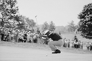 Arnold Palmer waves his putter and smiles after putting, and missing, a birdie on sixth green in second round of the U.S. Open Golf Championship, Friday, June 15, 1973, Oakmont, Pa. Palmer wound up first round with par 71.