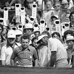 Arnold Palmer watches the flight of his ball on a chip shot from edge of 8th green at the Winged Foot Golf Club, Saturday, June 15, 1974, Mamaroneck, N.Y. Palmer, among the leaders, was playing in the third round of the 74th U.S. Open Golf Championship.