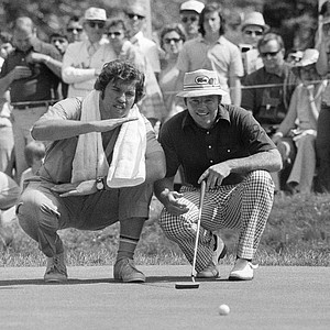 Jim Colbert's caddy, Steve Carlagola, explains contour of green on the second hole, Friday, June 14, 1974 at Winged Foot Golf Club in Mamaroneck, New York during second round of the 74th US Open golf championship. Colbert carded a two-over-par 72 in Thursday's opening round.