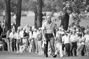 Arnold Palmer, a figure familiar to golf fans the world over strides to edge of the 9th green at Winged Foot Golf Club in Mamaroneck on June 14, 1974 during second round of the 74th U.S. Open Golf Championship.