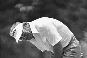 Arnold Palmer doubles over after missing a birdie putt on the 14th during the first round of the U.S. Open at Duluth, Ga on Thursday, June 17, 1976.
