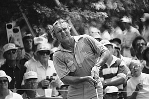A sweat soaked Arnold Palmer watches the flight of his ball as he drives from the third tee in the third round of the U.S. Open at Southern Hills Country Club in Tulsa on June 18, 1977. The temperature was in the upper 90's and golfers were complaining about the heat. Palmer started the third round with a 36-hole score of 142.