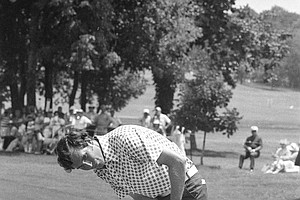 Hubert Green shows that his unusual putting grip works as the ball heads for the cup and a birdie during the second round of the U.S. Open at Southern Hills Country Club in Tulsa, Okla., on Friday, June 17, 1977.