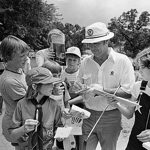Arnold Palmer one of golf's all time greats is still a favorite among the fans. A group of youngsters gather around Palmer to get his autograph after a practice round for the U.S. Open Golf Championship at Southern Hills Country Club, Tulsa, Okla., on Tuesday, June 15, 1977.