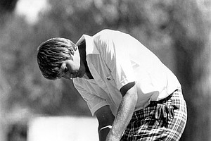 Andy North strokes birdie putt on the 384-yard par 4 seventh hole in the second round of the U.S. Open championship at Cherry Hills Country Club in Denver, Colo., Friday, June 17, 1978.