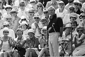 The gallery on the 18th hole looks pleased with a chip to the green, but Arnold Palmer, center, looks less than pleased with his shot during a practice round at Cherry Hills Country Club, June 12, 1978, Cherry Hills, Colo. Palmer, who won the 1960 US Open here, was among many golfers making practice rounds before Thursdays opening round of the 78th U.S. Open.