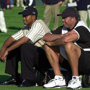 Tiger Woods shares a laugh with caddie, Steve Williams, as he waits to hit on the 14th fairway during the third round of the 100th U.S. Open Golf Championship at the Pebble Beach Golf Links in Pebble Beach, Calif., Saturday, June 17, 2000.