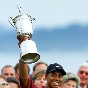 In this June 18, 2000 file photo, Tiger Woods holds up the winner's trophy after capturing the 100th U.S. Open Golf Championship at the Pebble Beach Golf Links in Pebble Beach, Calif. On his web site Friday night, Dec. 11, 2009, Woods announced that he is taking an indefinite break from professional golf.