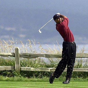 Tiger Woods drives the 18th hole on his way to winning the 100th U.S. Open Golf Championship at the Pebble Beach Golf Links in Pebble Beach, Calif., Sunday, June 18, 2000. Woods finished at 12-under 272, 15 strokes ahead his nearest competitor.
