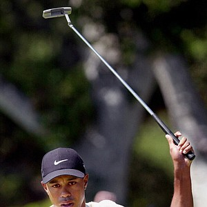 Tiger Woods reacts after sinking a birdie putt on the second hole during the third round of the 100th U.S. Open Golf Championship at the Pebble Beach Golf Links in Pebble Beach, Calif., Saturday, June 17, 2000.