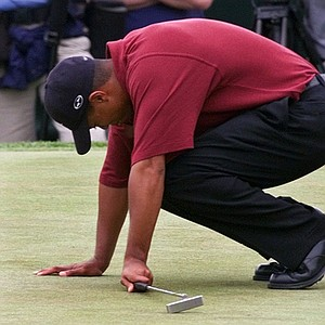 Tiger Woods reacts to a missed birdie on the third hole during the final round of the 100th U.S. Open Golf Championship at the Pebble Beach Golf Links in Pebble Beach, Calif., Sunday, June 18, 2000.