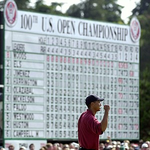 Tiger Woods celebrates on the 18th green after winning the 100th U.S. Open Golf Championship at the Pebble Beach Golf Links in Pebble Beach, Calif., Sunday, June 18, 2000. Tiger Woods won the U.S. Open by a record 15 strokes.
