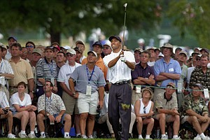 Tiger Woods watches his shot from the first cut as the gallery looks on from behind on the third hole during the first round at the U.S. Open at the Southern Hills Country Club in Tulsa, Okla., Thursday, June 14, 2001.