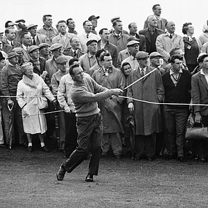 Arnold Plamer and spectators watch flight of his ball after he hit an iron shot from fairway on front nine of the Birkdale golf course on july 15, 1961 at Birkdale, England, during play in the British open golf Tournament.