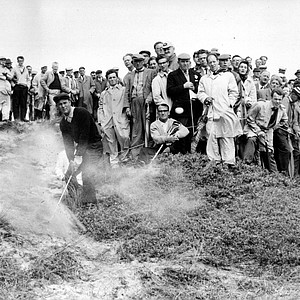 Arnold Palmer of Latrobe, Pa., blasts his way out of a sandy bunker during the British Open Championship at Birkdale, England, July 13, 1961.
