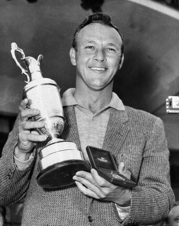 Arnold Palmer smiles with his trophy and medal after winning the British Open Golf Championship by a single stroke at Royal Birkdale course in Birkdale, Lancashire, England, July 15, 1961.