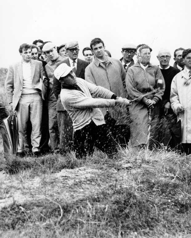 Gary Player, of South Africa, plays out of a bunker in the first round of the British Open Golf Championship at Birkdale, Lancashire, England on July 12, 1961.