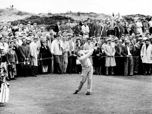 Gallerites watch Arnold Palmer hit an iron shot on the 11th hole at Troon, Scotland, July 11, 1962, in opening round of the British Open Golf Championship.