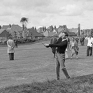 Bob Charles, the southpaw from New Zealand, watches a big divot fly after hitting from rough on second hole in the morning round in 36-hole playoff final for the British Open Championship at Royal Lytham and St. Anne's in Lancashire, England, on July 13, 1963.