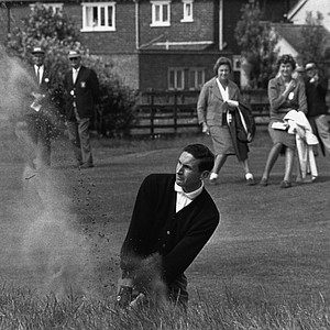 Bob Charles, of New Zealand, sends out a plume of sand as he hits out of a bunker at the third against Phil Rodgers, of United States, in the British Open Championship Playoff at the Royal Lytham and St. Anne's Club in Lancashire, England on July 13, 1963.